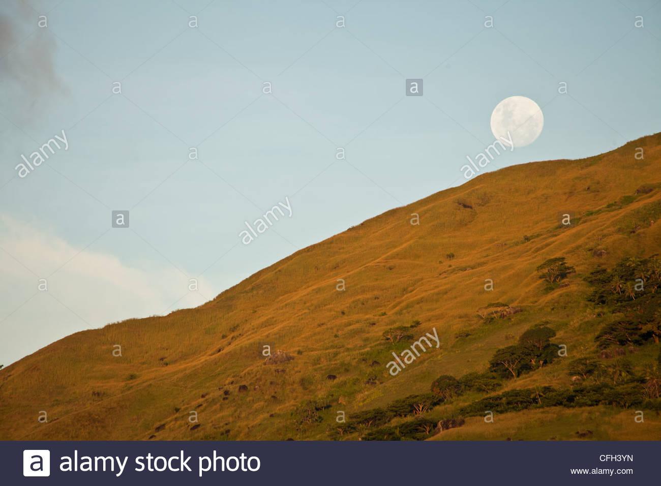 Moonrise seen looking at Southern Yasawa Island of Vanu Levu. - Stock Image