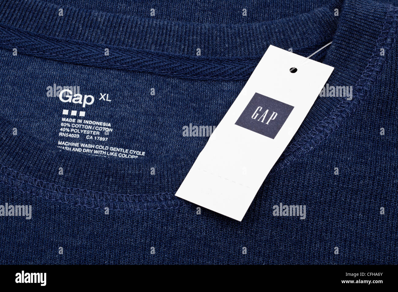 Gap top with clothes labels and tag - Stock Image