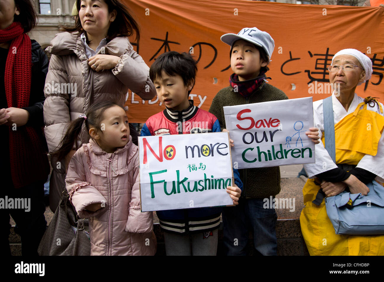 Peace walkers in NYC on their way to Indian Point Nuclear Power Plant on 1 year anniversary of the Fukushima nuclear - Stock Image