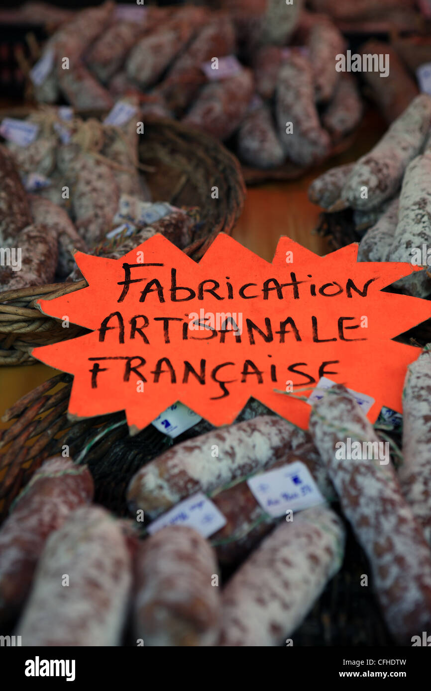 French artisan sausages on sale at a market in Brantome in the Dordogne region of France - Stock Image