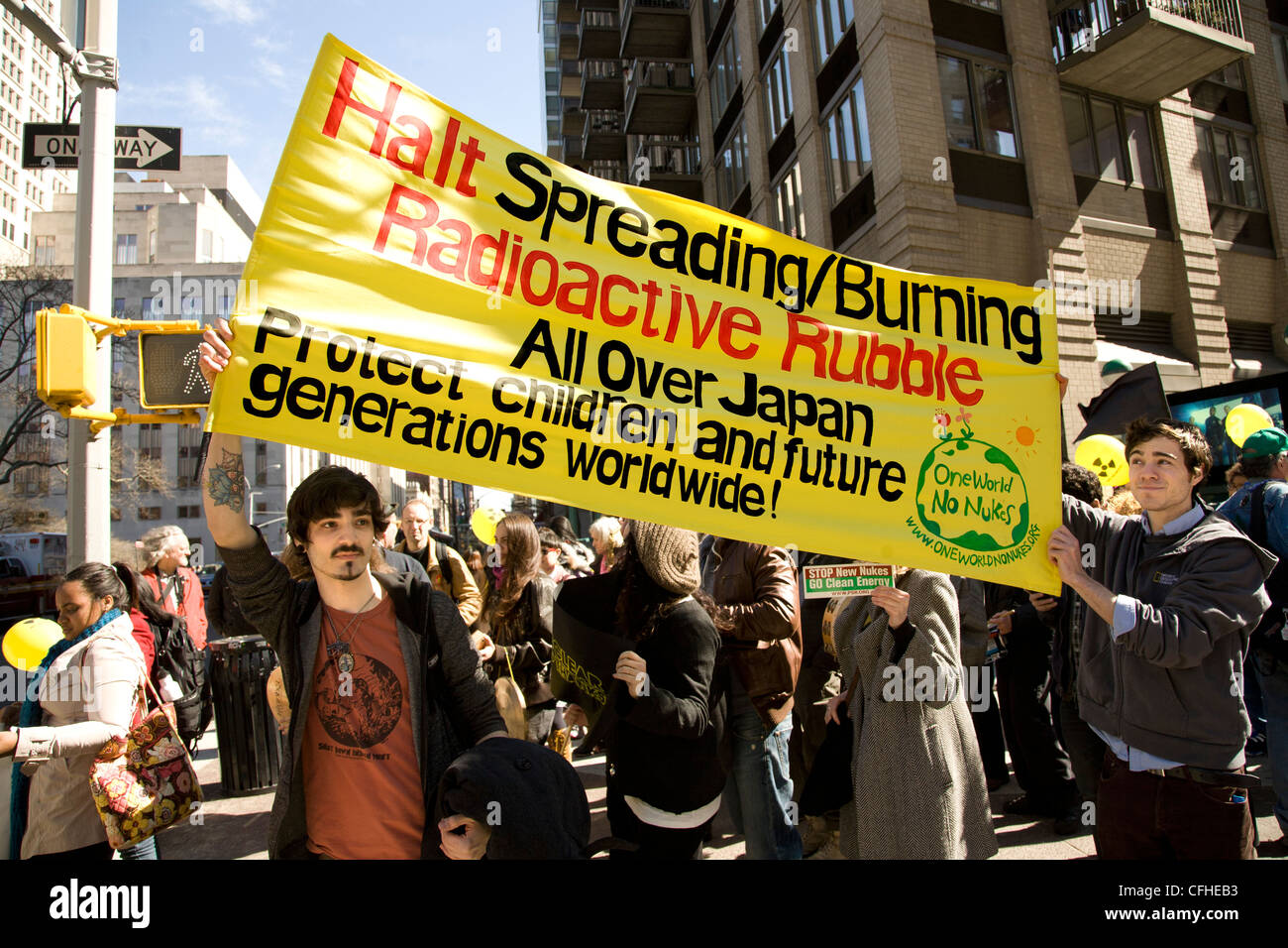 AntiNuclear rally & march in New York City commemorating the 1 year anniversary of the natural and nuclear disaster - Stock Image
