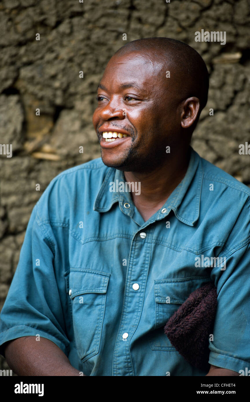 Fair trade vanilla and cocoa farmer outside his home in the Rwenzori Mountains near Bundibugyo, Uganda. - Stock Image