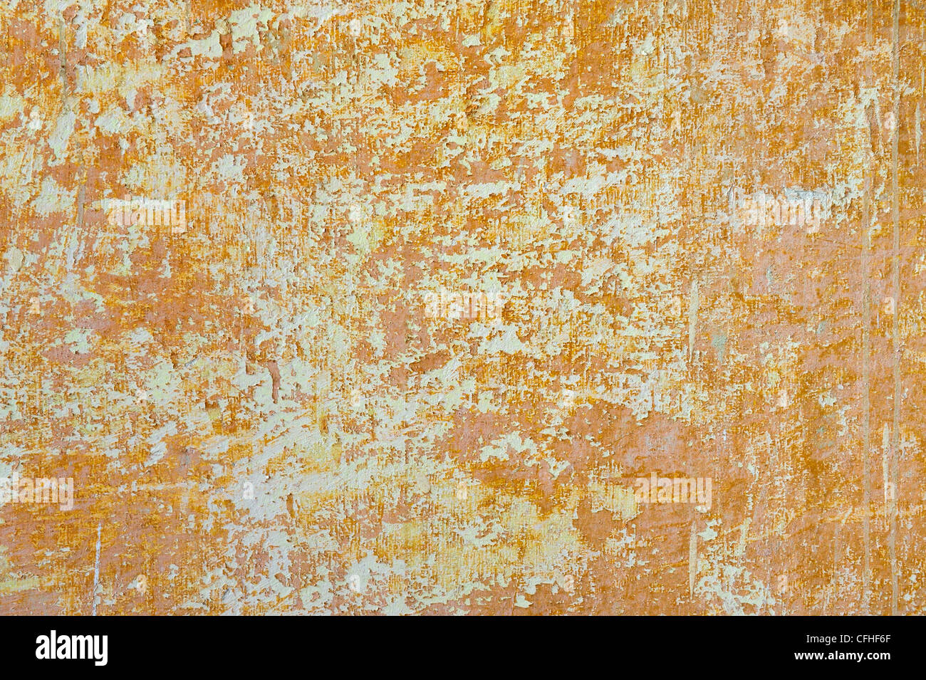 Grungy background. Old scratched orange wall. - Stock Image