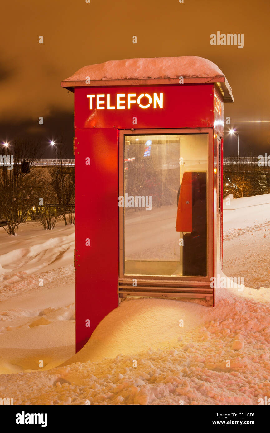 Norwegian telephone box buried in a snow drift Tromso Troms North Norway Scandinavia Europe - Stock Image