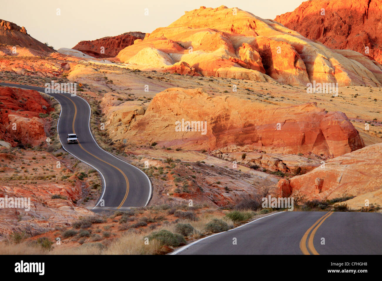 Winding roadway in the park near sunset - Stock Image
