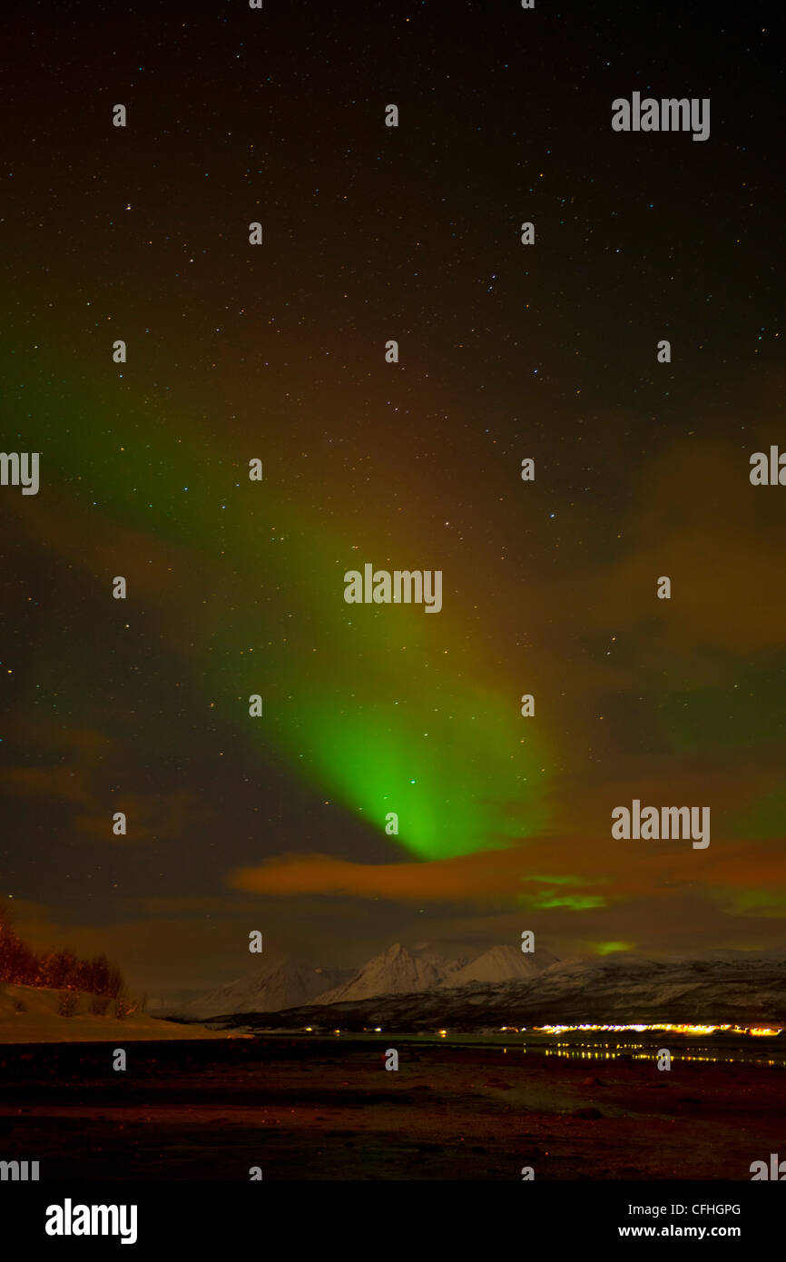 Aurora borealis or northern lights seen over the Lyngen alps, from Sjursnes, Ullsfjord, Troms, North Norway, Europe - Stock Image