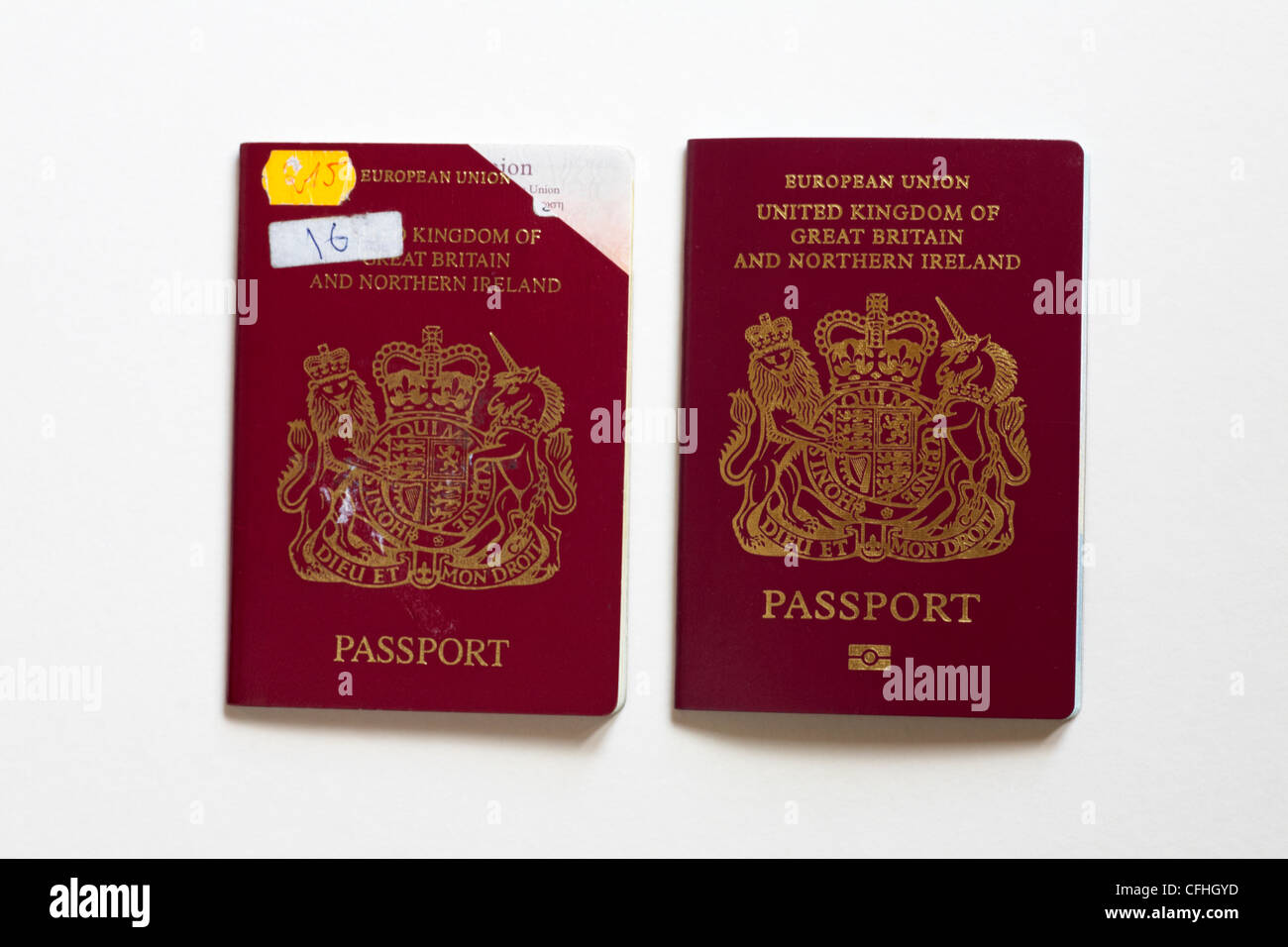 Expired Passport With Corner Cut Off And Replacement Passport Isolated On White Background