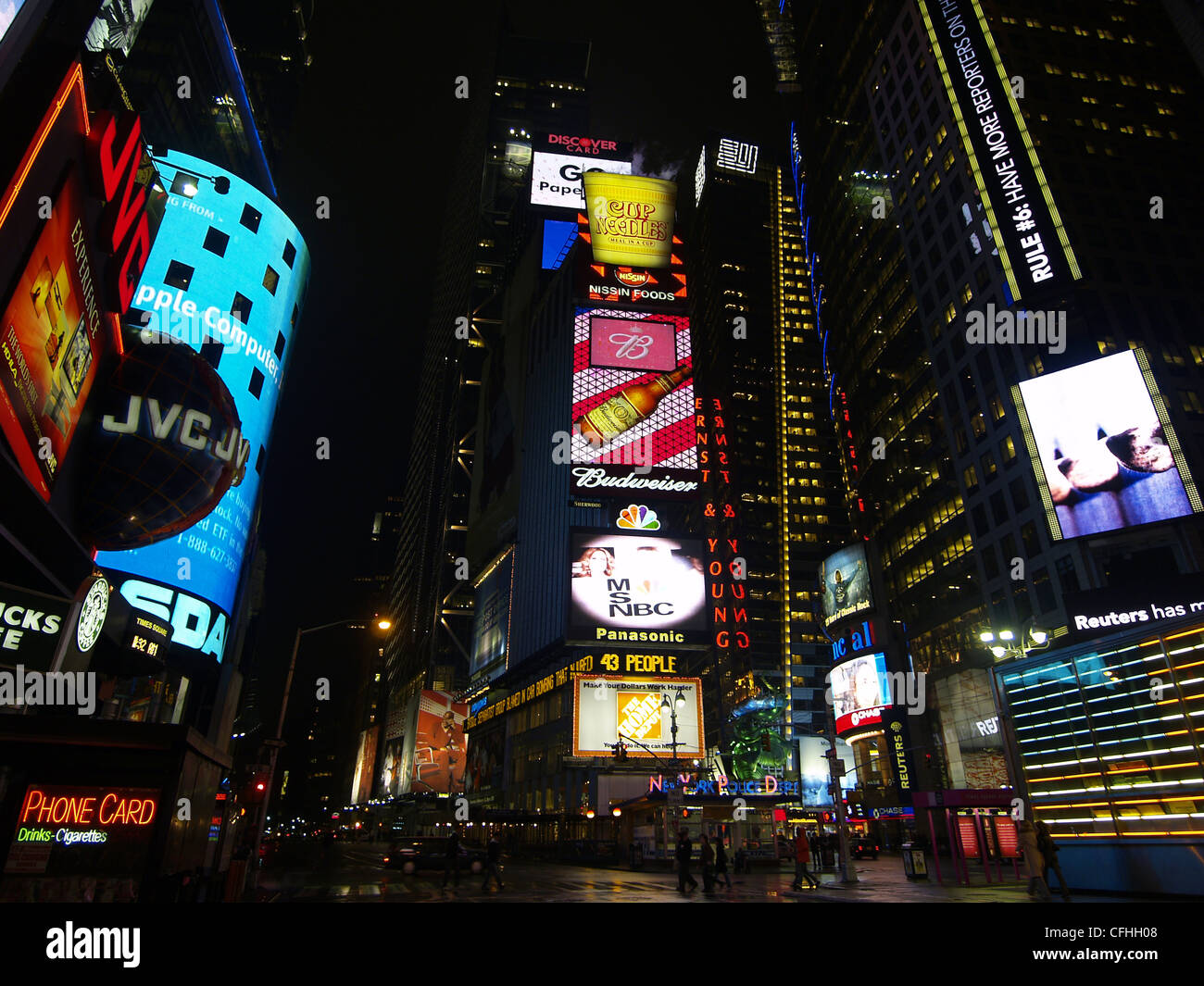 The colorful neon signs at Times Square in New York at night - Stock Image
