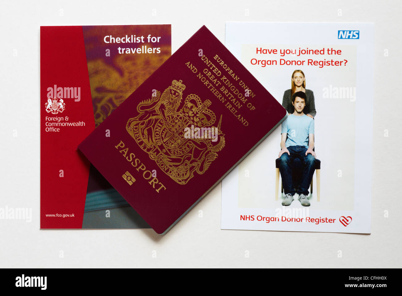 new passport received together with checklist for travellers and NHS leaflet Have you joined the Organ Donor Register - Stock Image