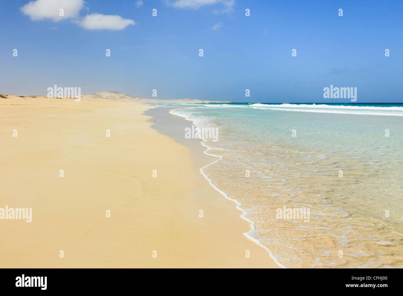 Praia de Chaves, Rabil, Boa Vista, Cape Verde Islands. View along shoreline of empty long white sand beach with - Stock Image