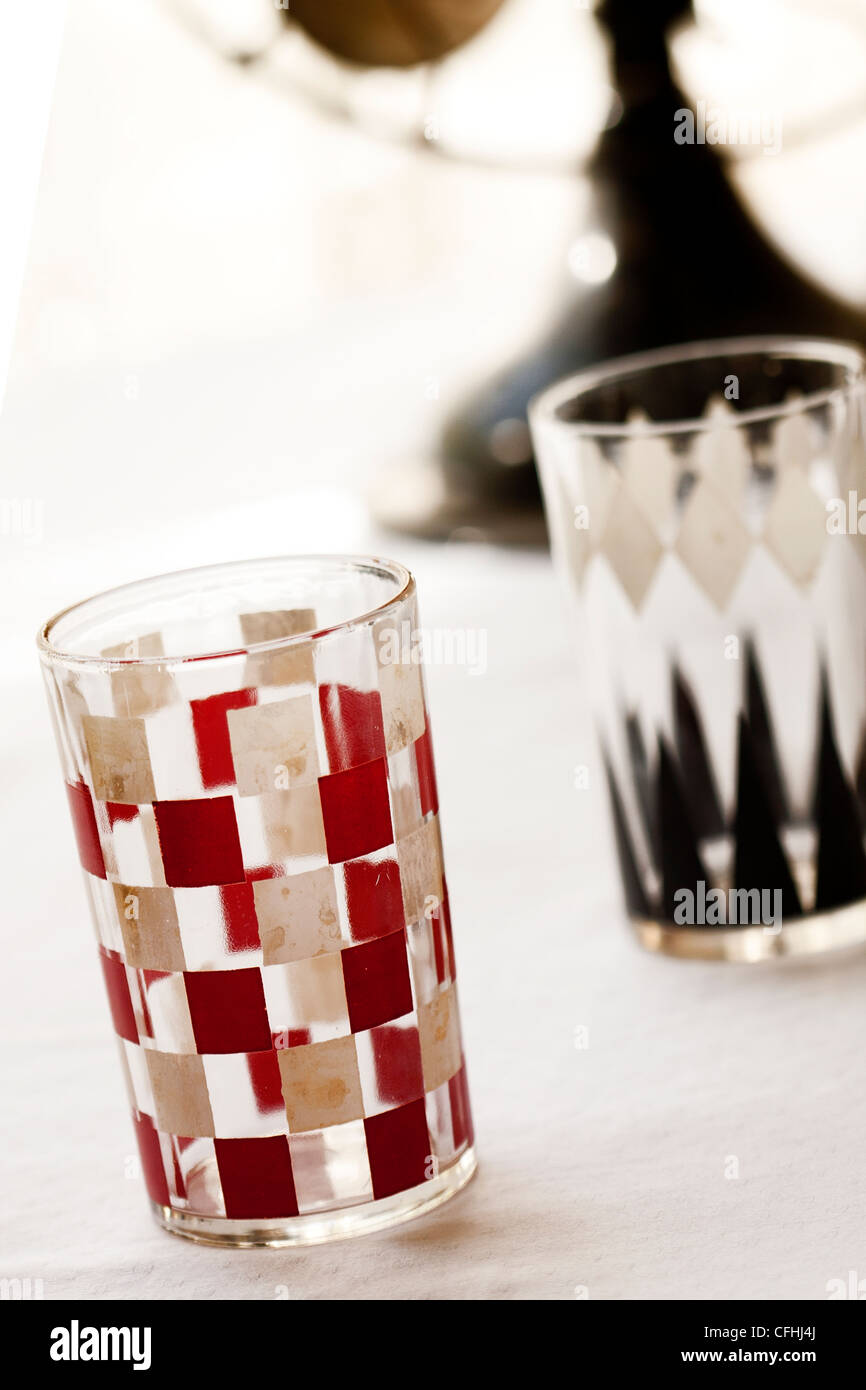 Vintage, mid-century modern drinking glasses in backgammon and checkerboard pattern - Stock Image