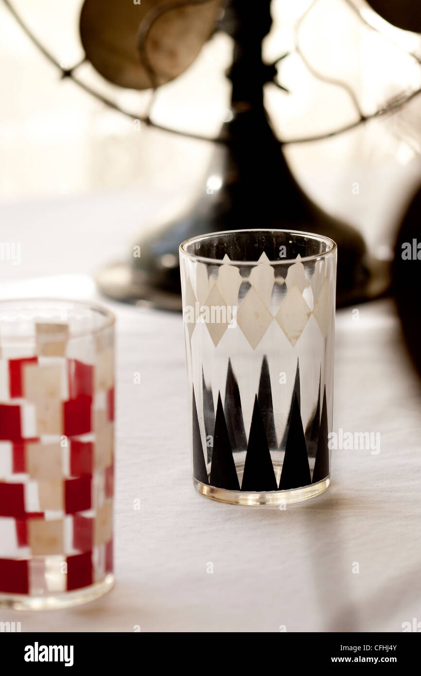 Mid-century modern drinking glasses in backgammon and checkerboard patterns - Stock Image