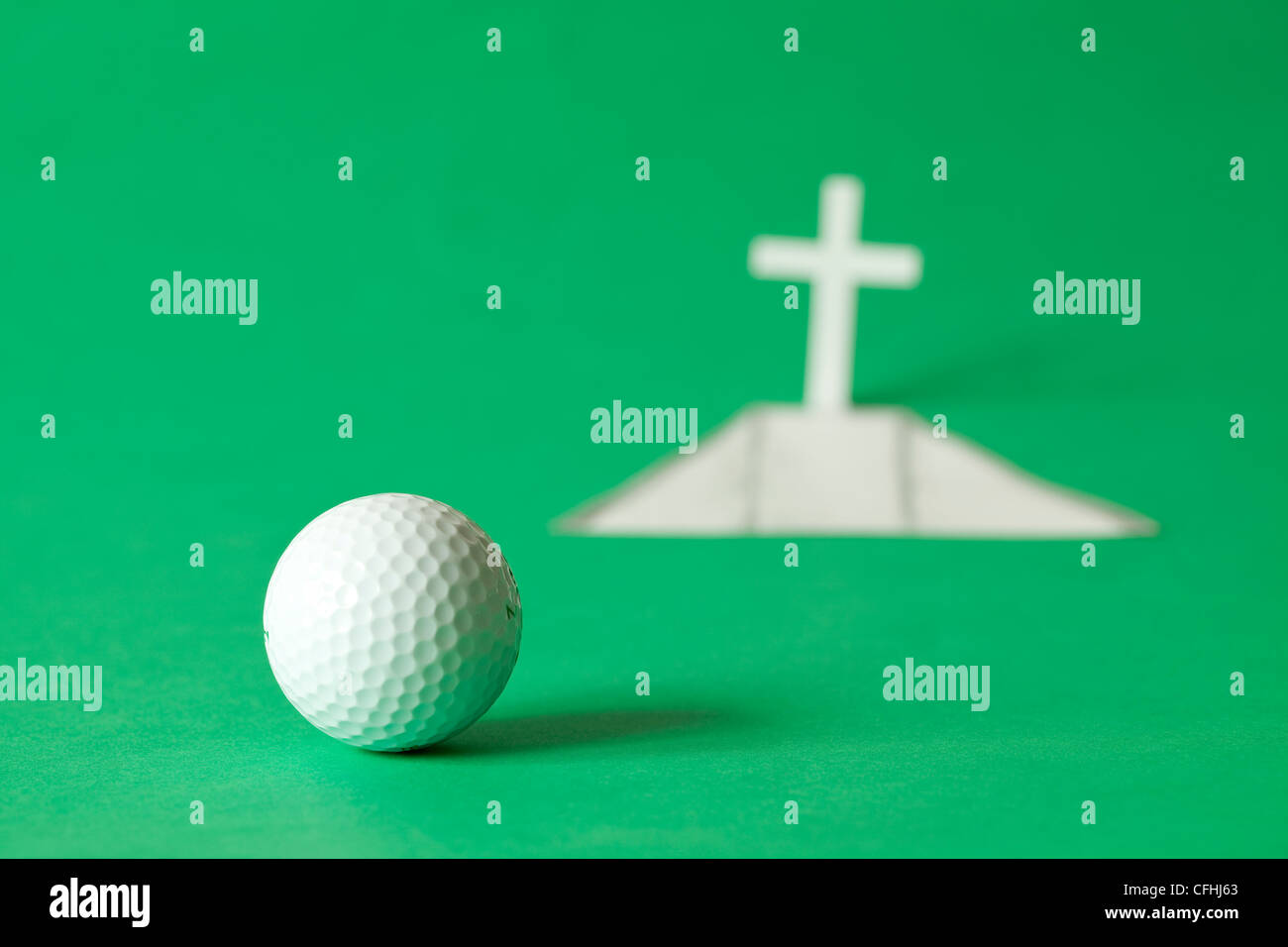 white golf ball by final hole - Stock Image