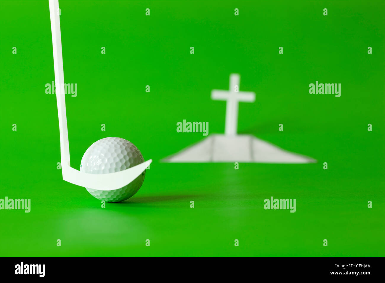 last blow white golf ball by final hole - Stock Image