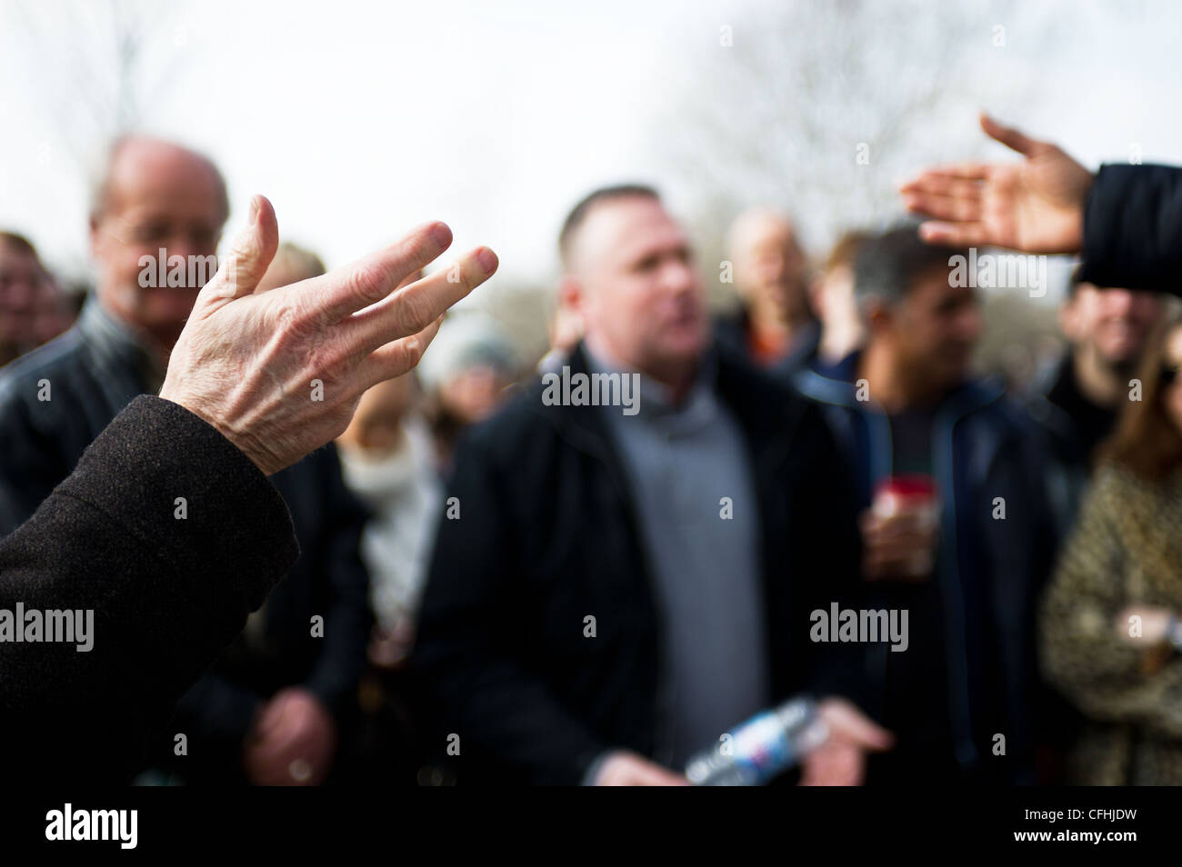 People making gestures at Speakers Corner in London - Stock Image