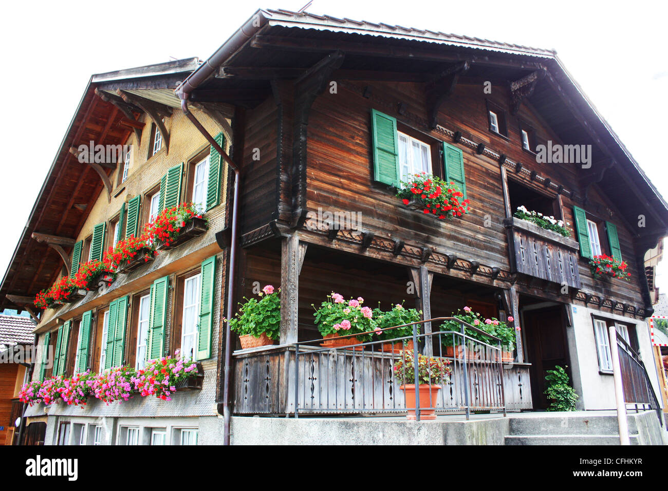 Swiss wooden chalet with window plants Stock Photo