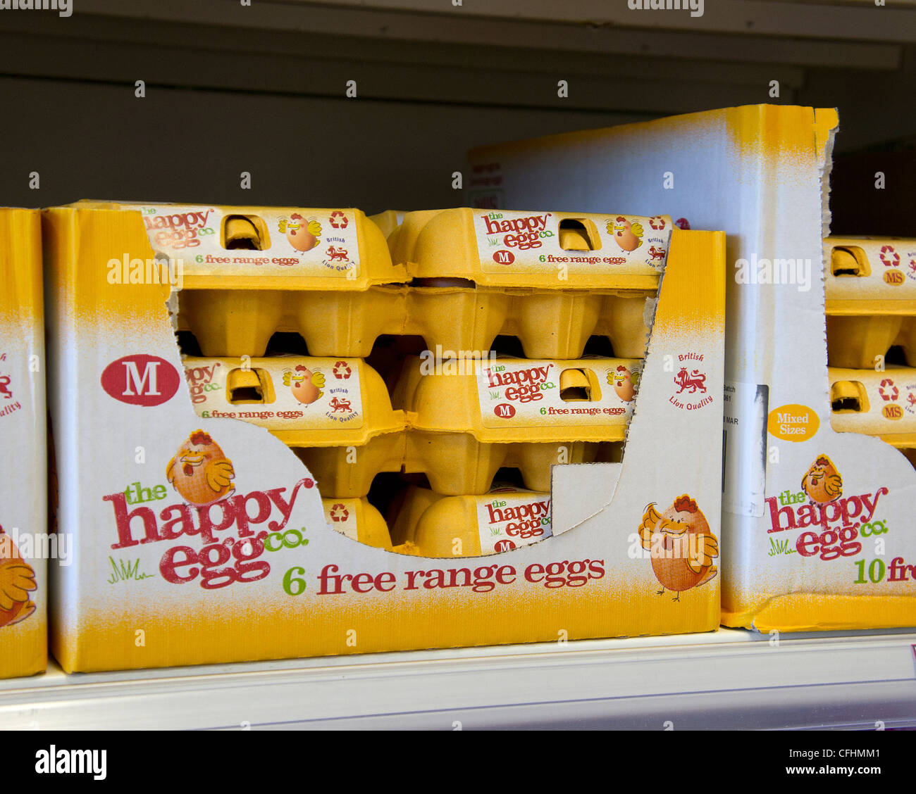 Boxes of  free range ' happy eggs '  in a uk supermarket - Stock Image