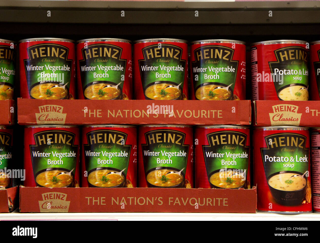 Tins of Heinz soup on a store shelf, UK - Stock Image