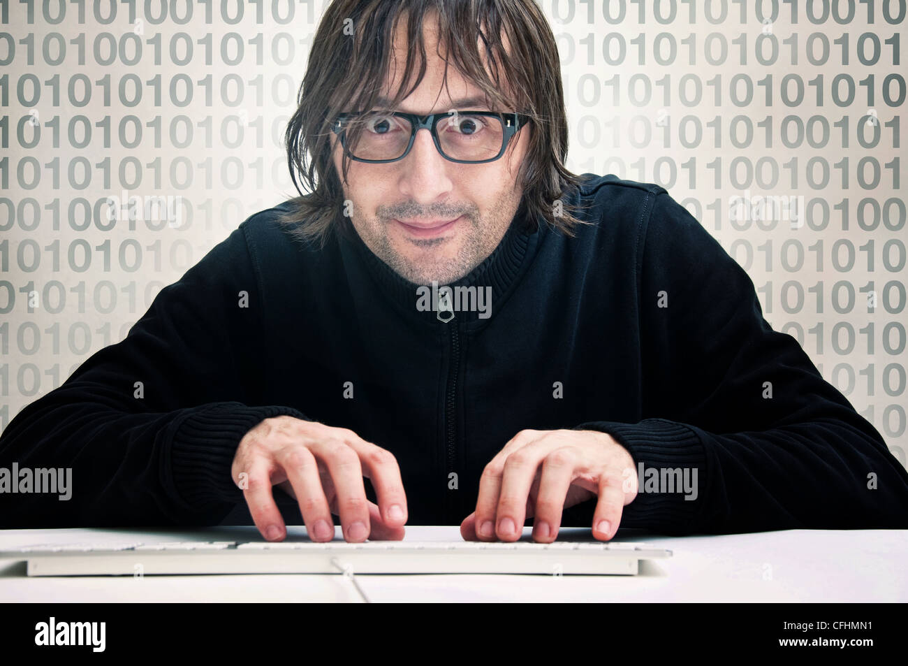Man is typing on computer keyboard, computer hacker concept - Stock Image