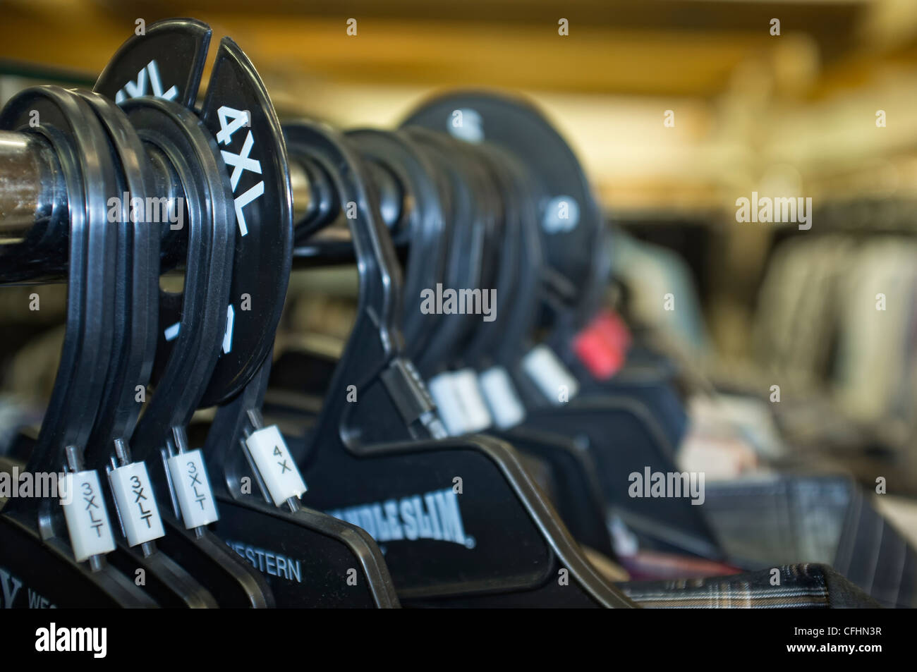 Hangers at apparel store - oversize 4XL - Stock Image