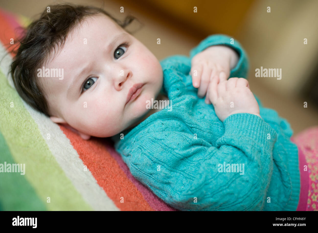 Beautiful baby girl with blue eyes and brown hair lying on ... Cute Baby Girls With Brown Hair And Blue Eyes