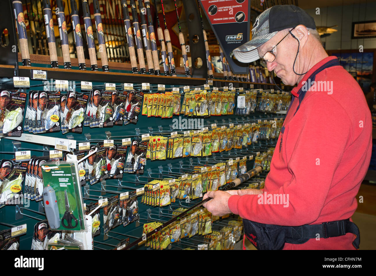Man shopping for fishing equipment at Bass Pro store in San
