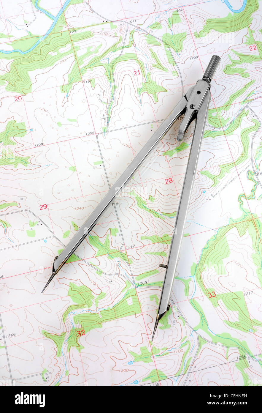 A cartographer's divider measuring distance on a topographic map. (USGS topographic map in the public domain). - Stock Image