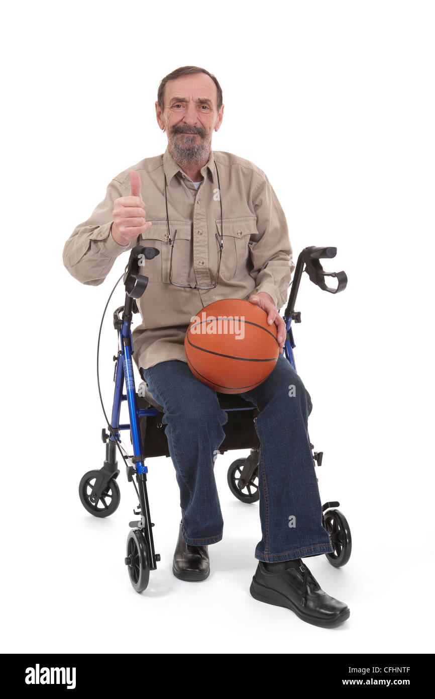 man giving a thumb up for disabled sports sitting on a disability walker - Stock Image