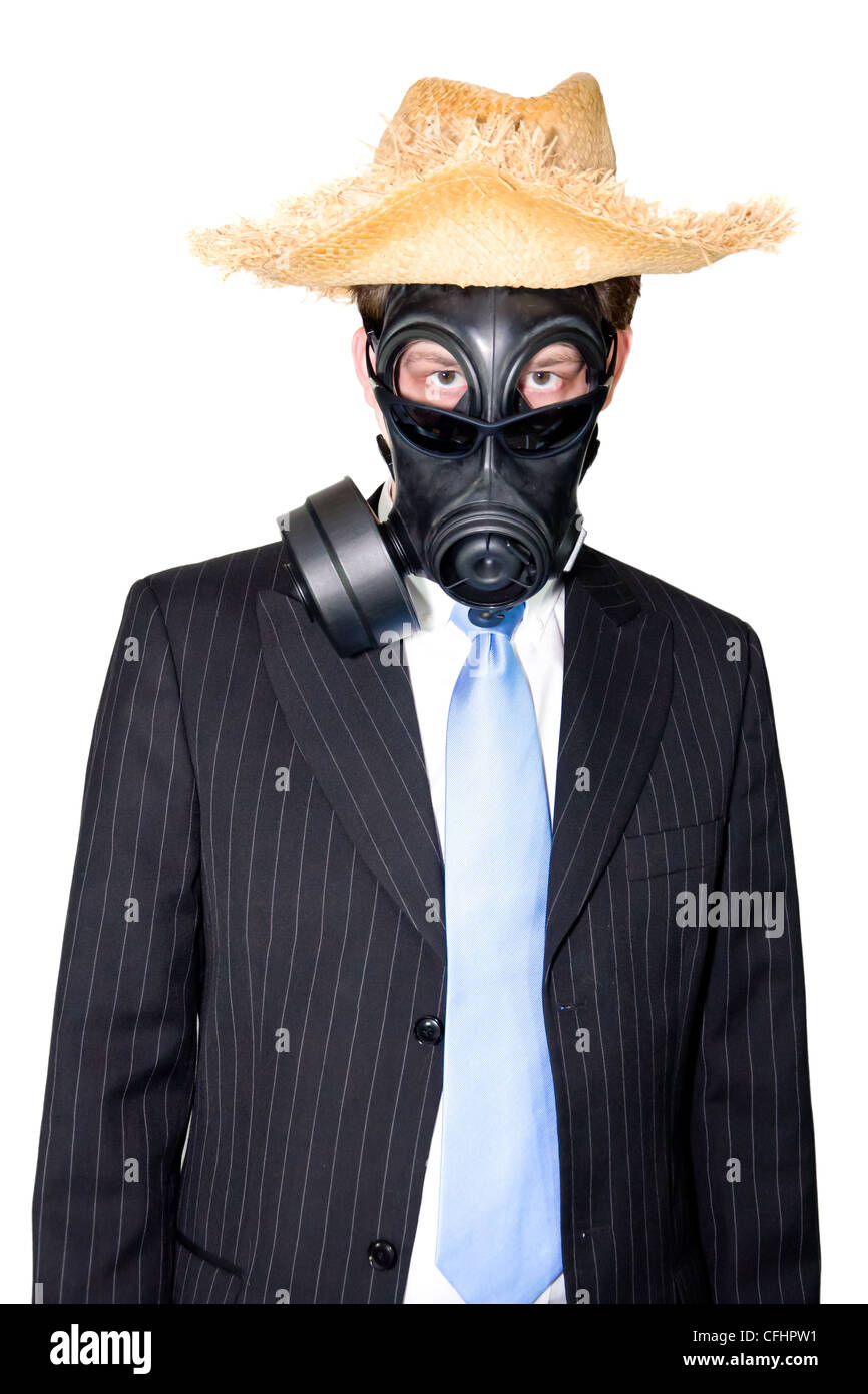 Picture of a man in a suit and gasmask and wearing sunglasses.. - Stock Image