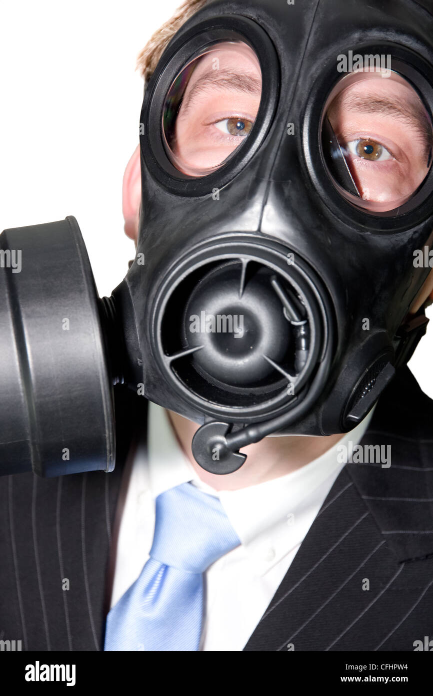 Closeup picture of a man with gasmask and suit on white - Stock Image