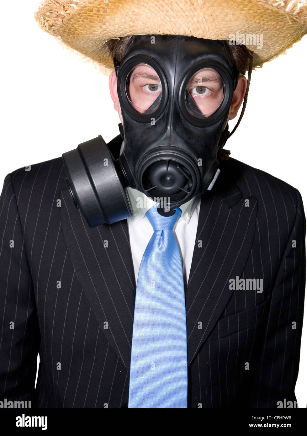 Picture of a man in suit with a gasmask and a hat - Stock Image