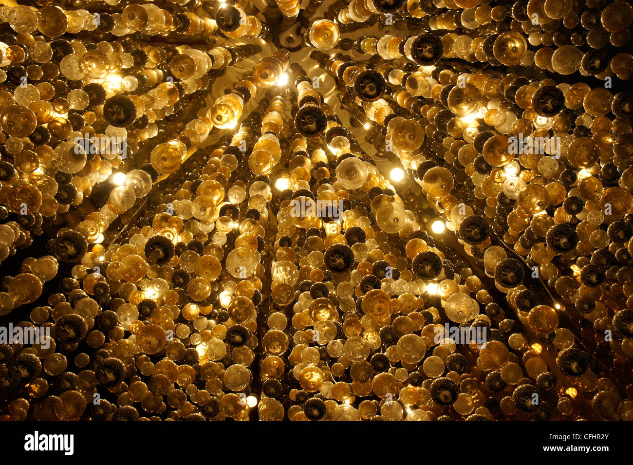abstract lights on golden colored background - Stock Image