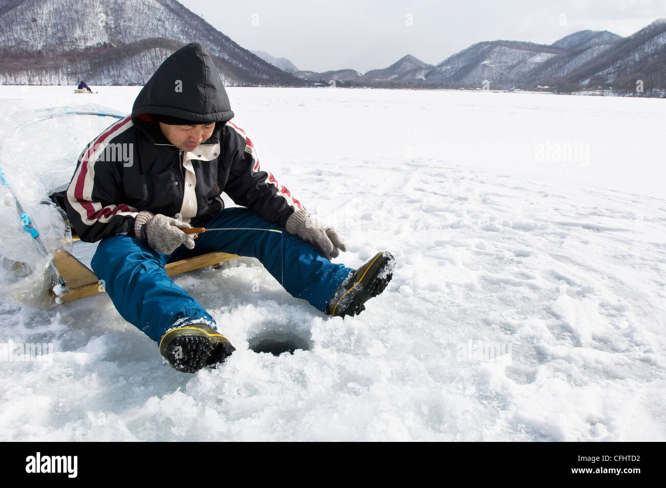Fishermen ice fishing on Haruna Lake in Gunma Japan Stock Photo