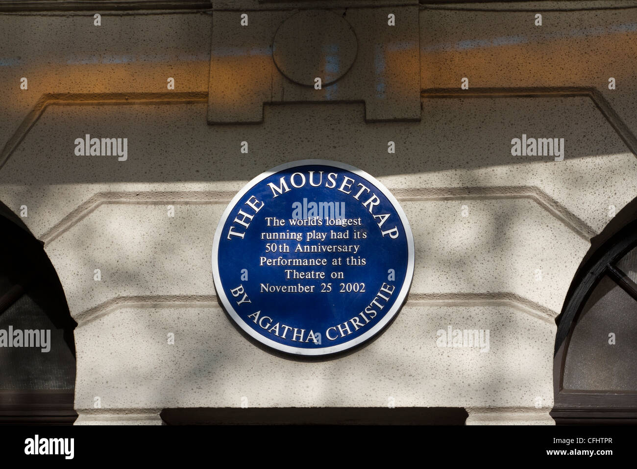 Blue plaque on St Martins Theatre,London commemorating  the 50th anniversary of the Agatha Christie play The Mousetrap. - Stock Image