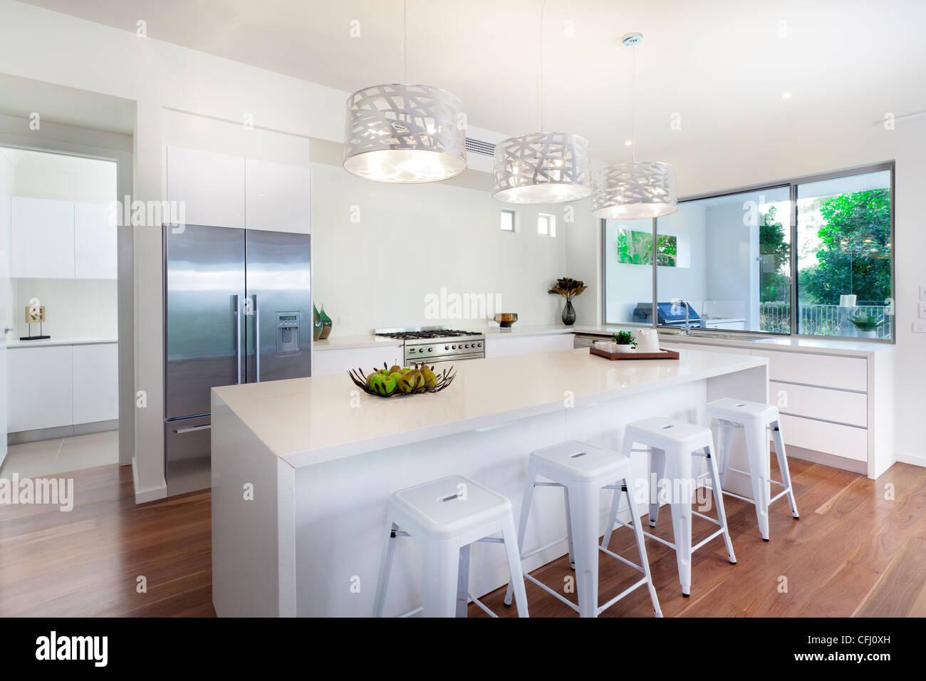 Stylish open plan kitchen overlooking the backyard Stock Photo ...