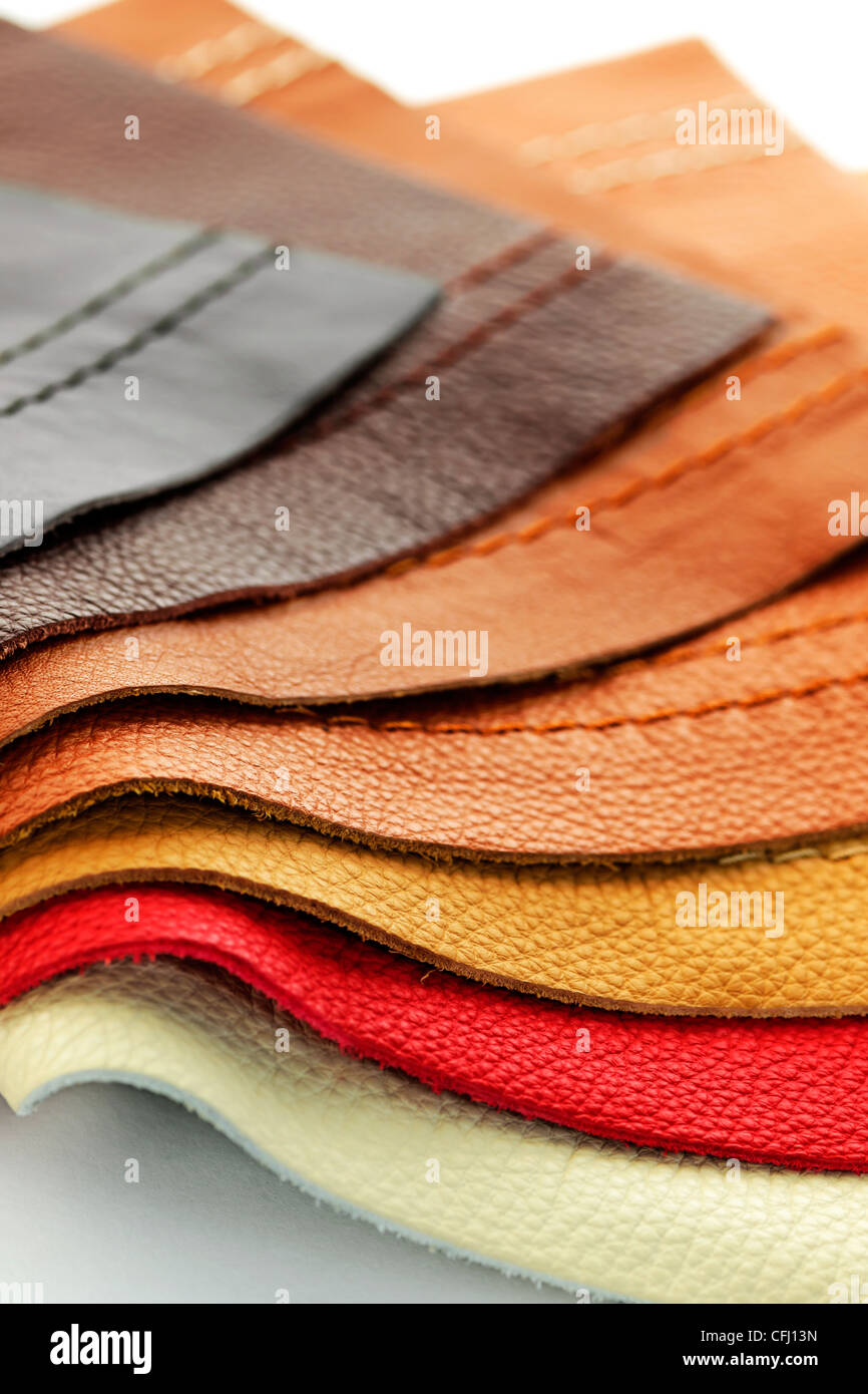 Natural leather upholstery samples with stitching in various colors - Stock Image