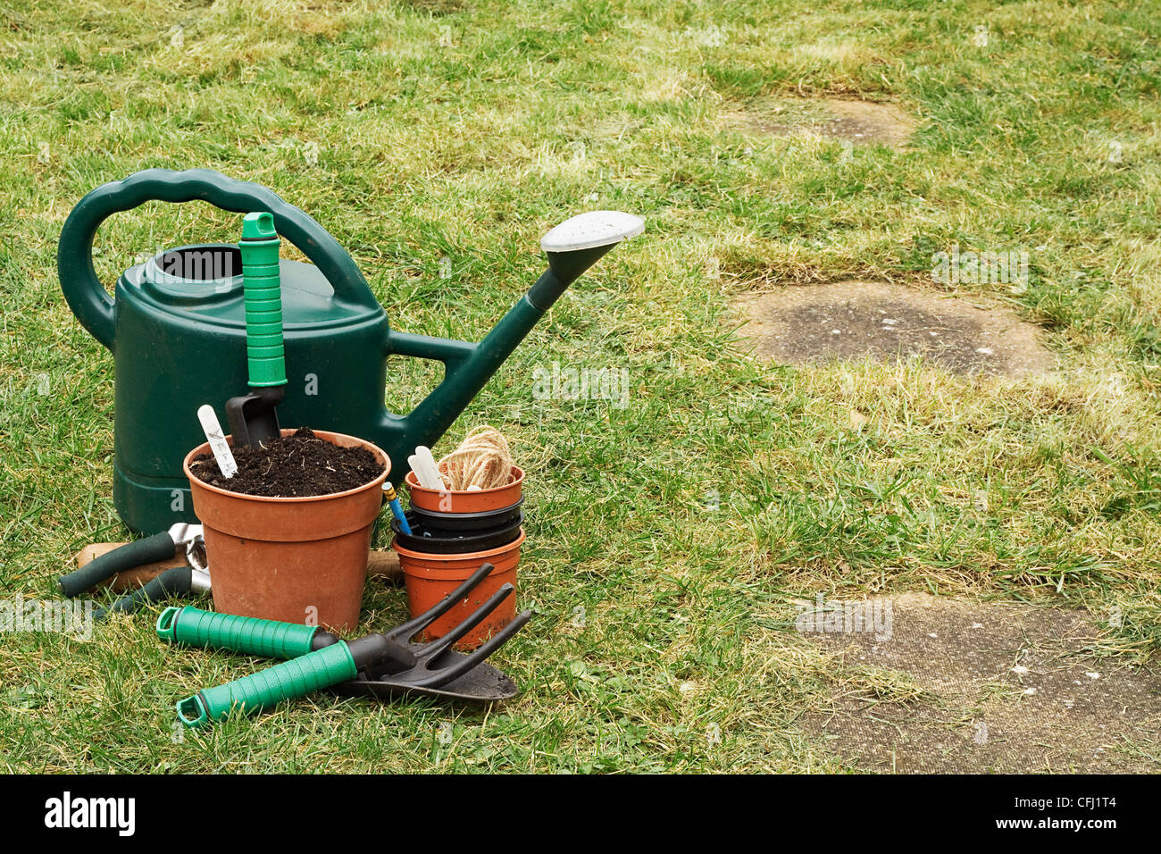 A selection of Garden utensils on the lawn Stock Photo