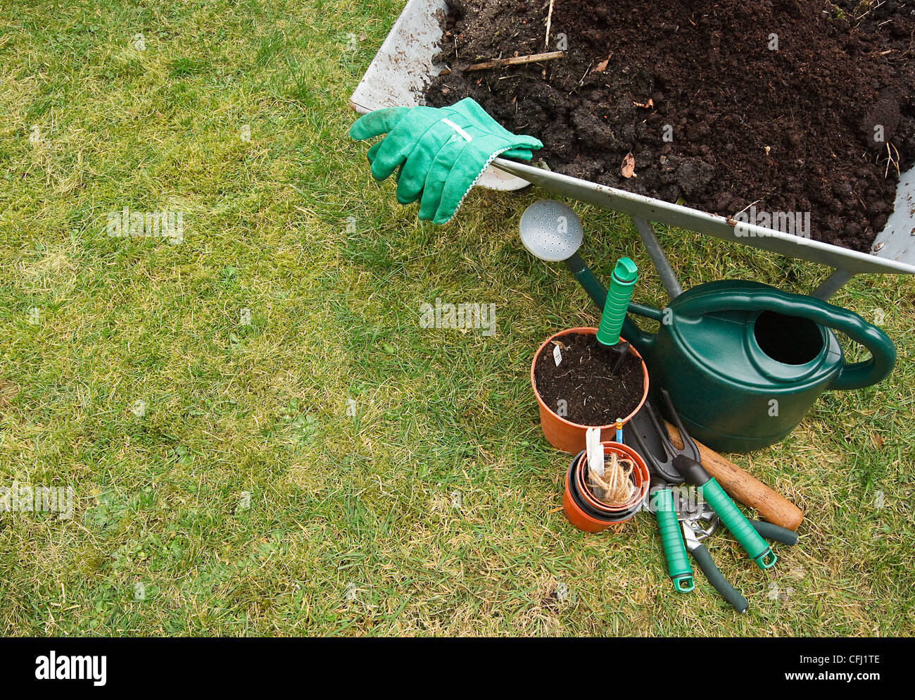 Gardeners utensils on a grass lawn - Stock Image
