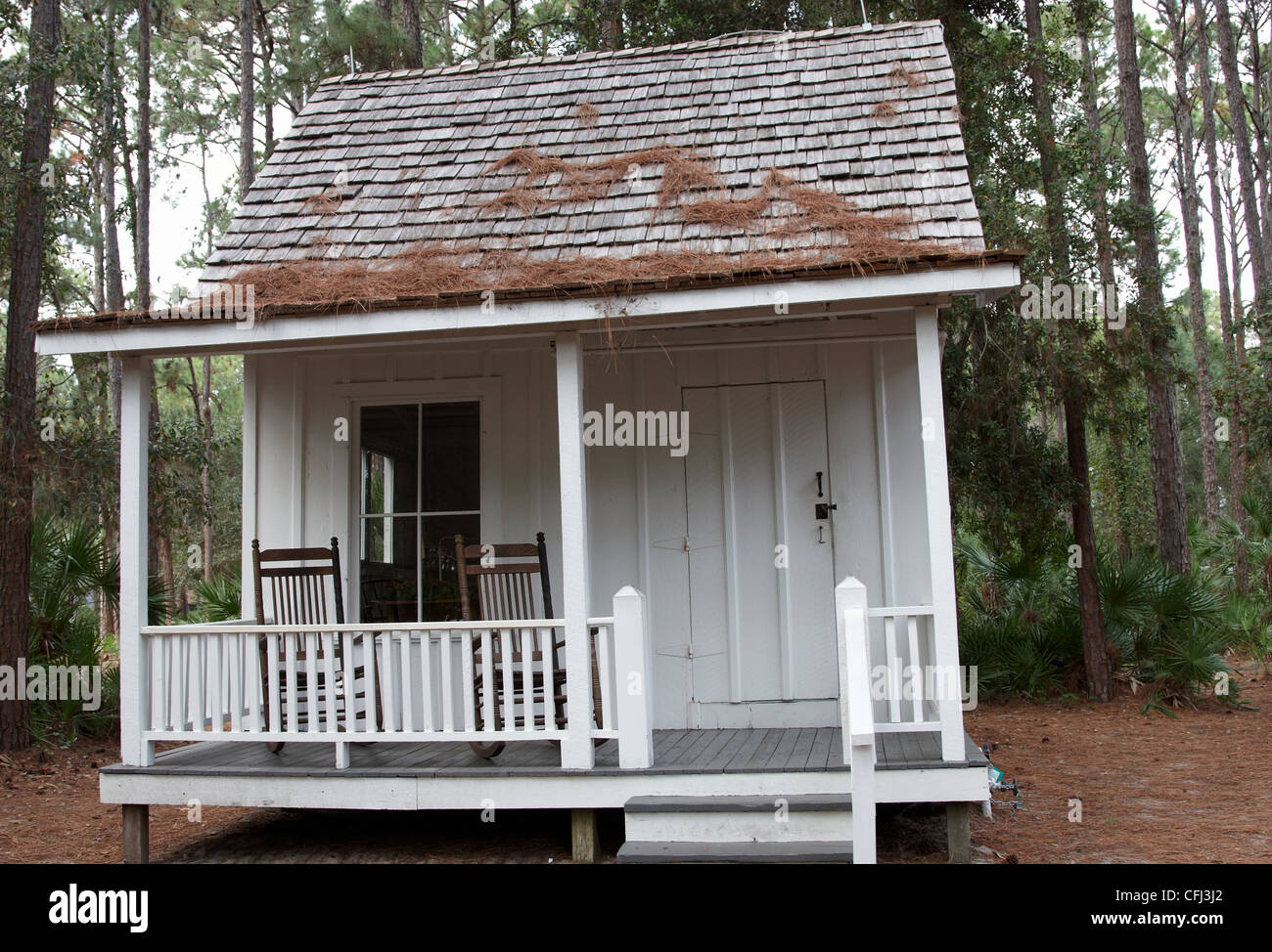 A Small House In The Woods With Chairs On He Veranda   Stock Image