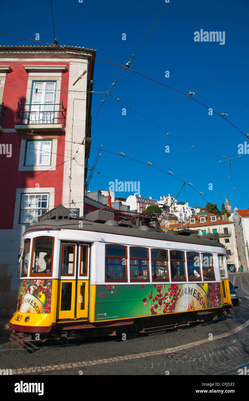 Tram 28 going through Alfama district central Lisbon Portugal Europe - Stock Image