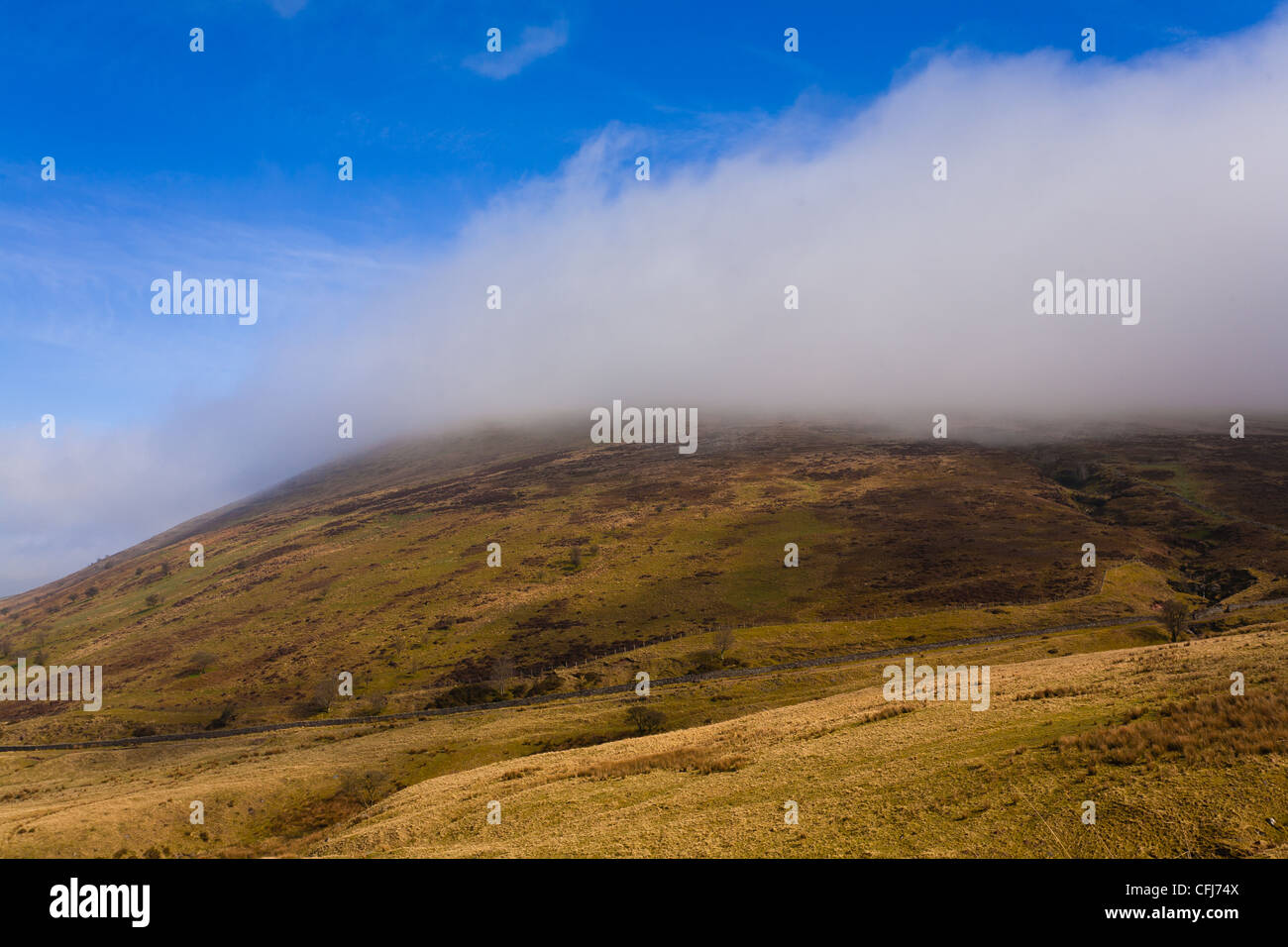 Mists forming on The  Summit of Corn Ddu in The Brecon beacons - Stock Image