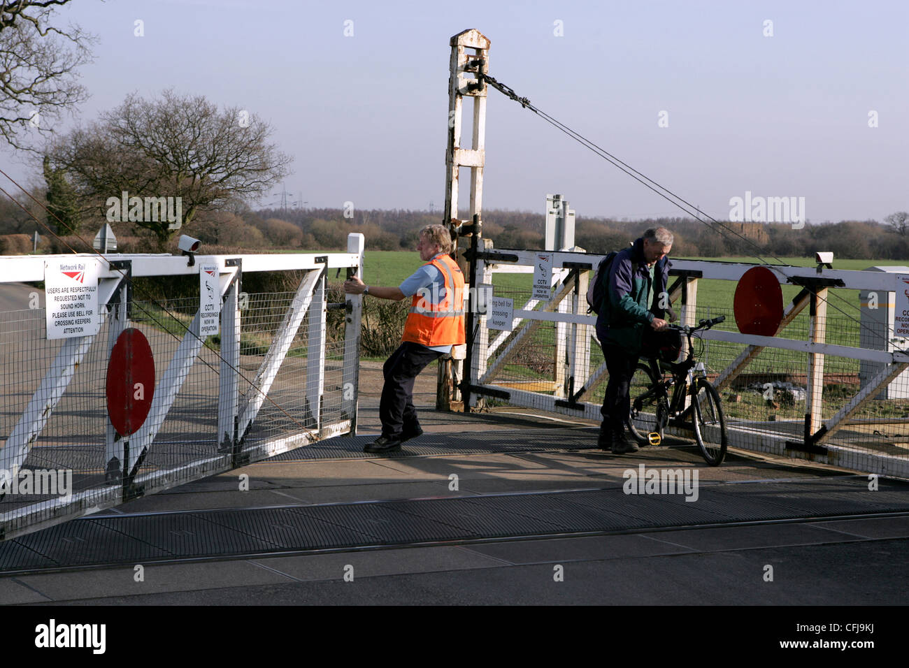 Gated railway crossing at Joan Croft junction ECML Network Rail march 2012. - Stock Image