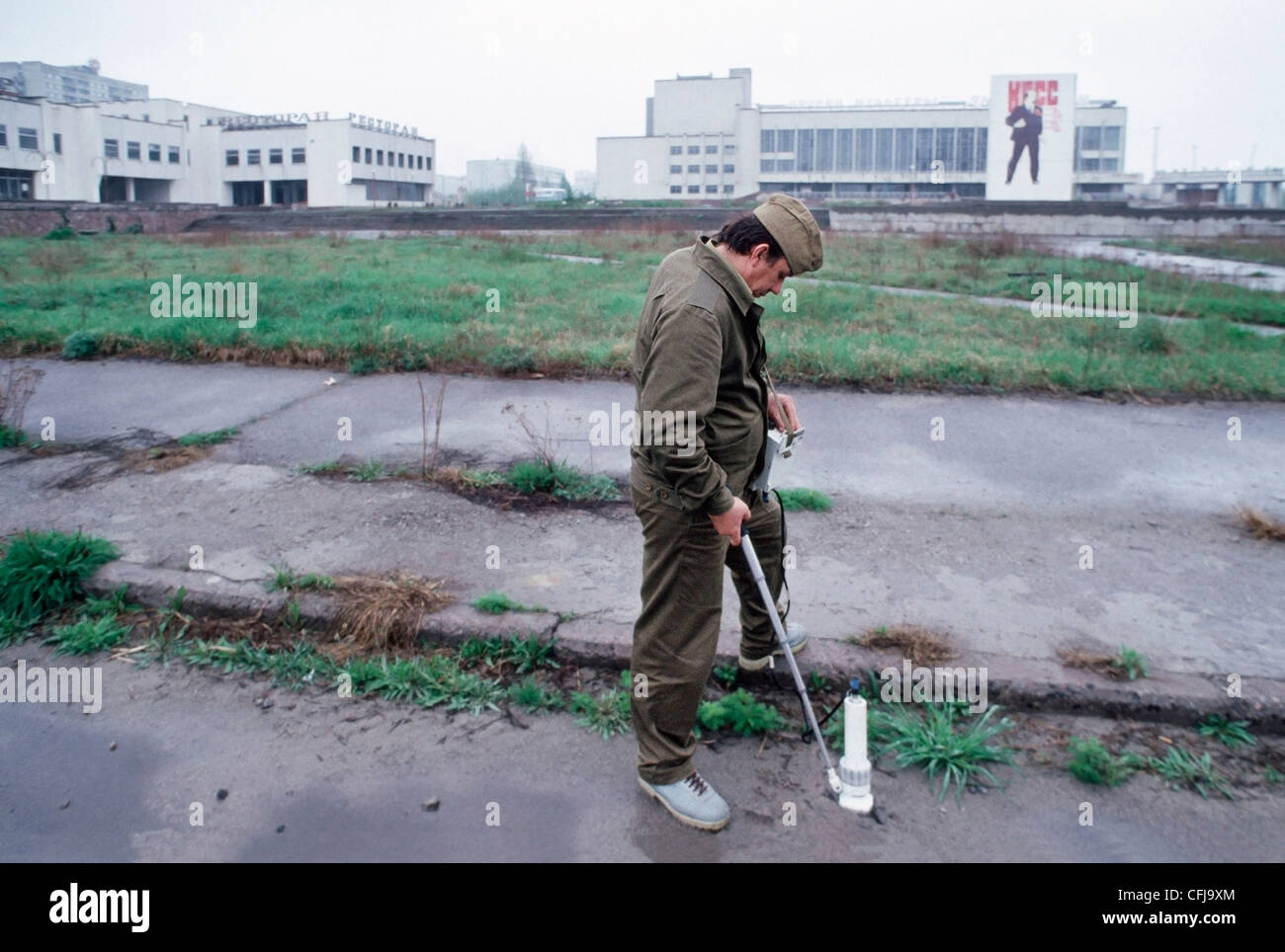 Worker measuring ground radiation in Lenin Square in Pripyat, less than two miles from Chernobyl station, Ukraine. - Stock Image