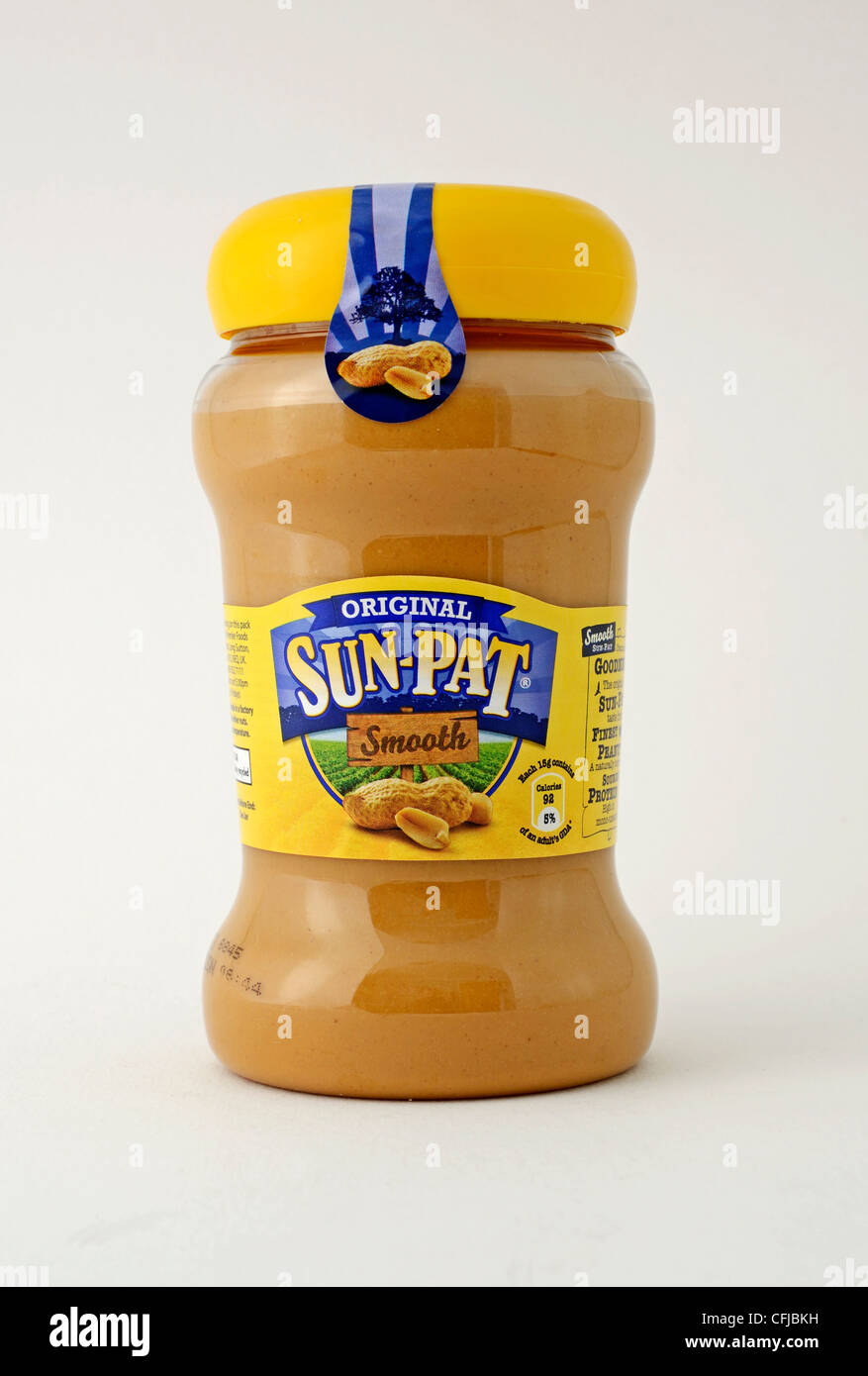 a glass jar of Sun-Pat smooth peanut butter on a white background - Stock Image