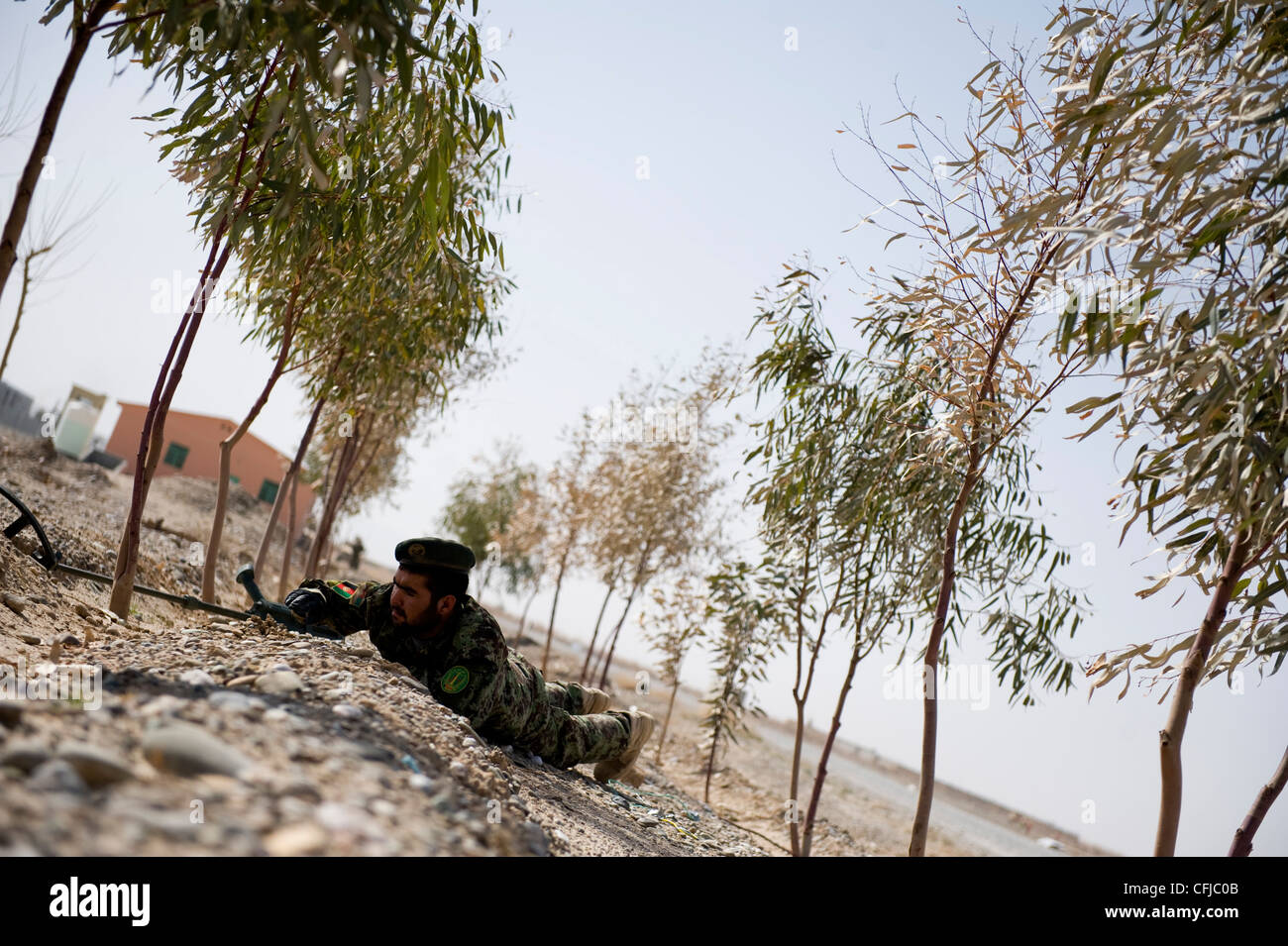 KANDAHAR, Afghanistan - Fakhr Uddin, an Afghan National Army soldier, trains during practice counter-IED operations - Stock Image