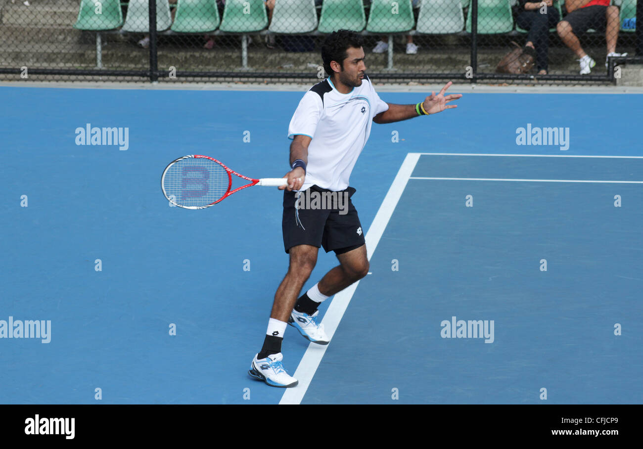 MELBOURNE, AUSTRALIA - JANUARY 21, 2012: tennis player Aisam Ul Haq Qureshi hits a forehand at the 2012 Australian - Stock Image