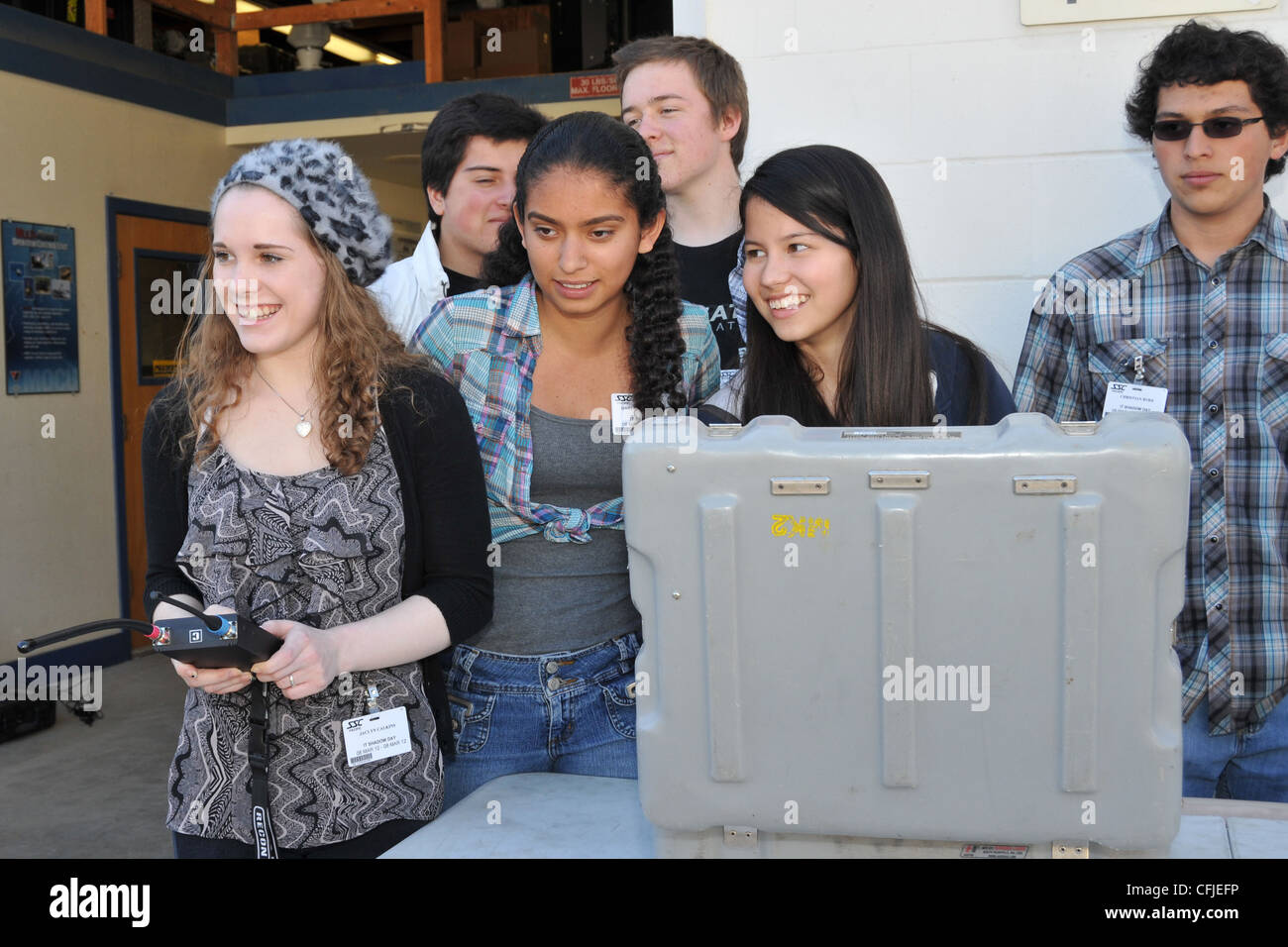 Local area high school students operate robots while touring the Space and Naval Warfare Systems Center Pacific's - Stock Image