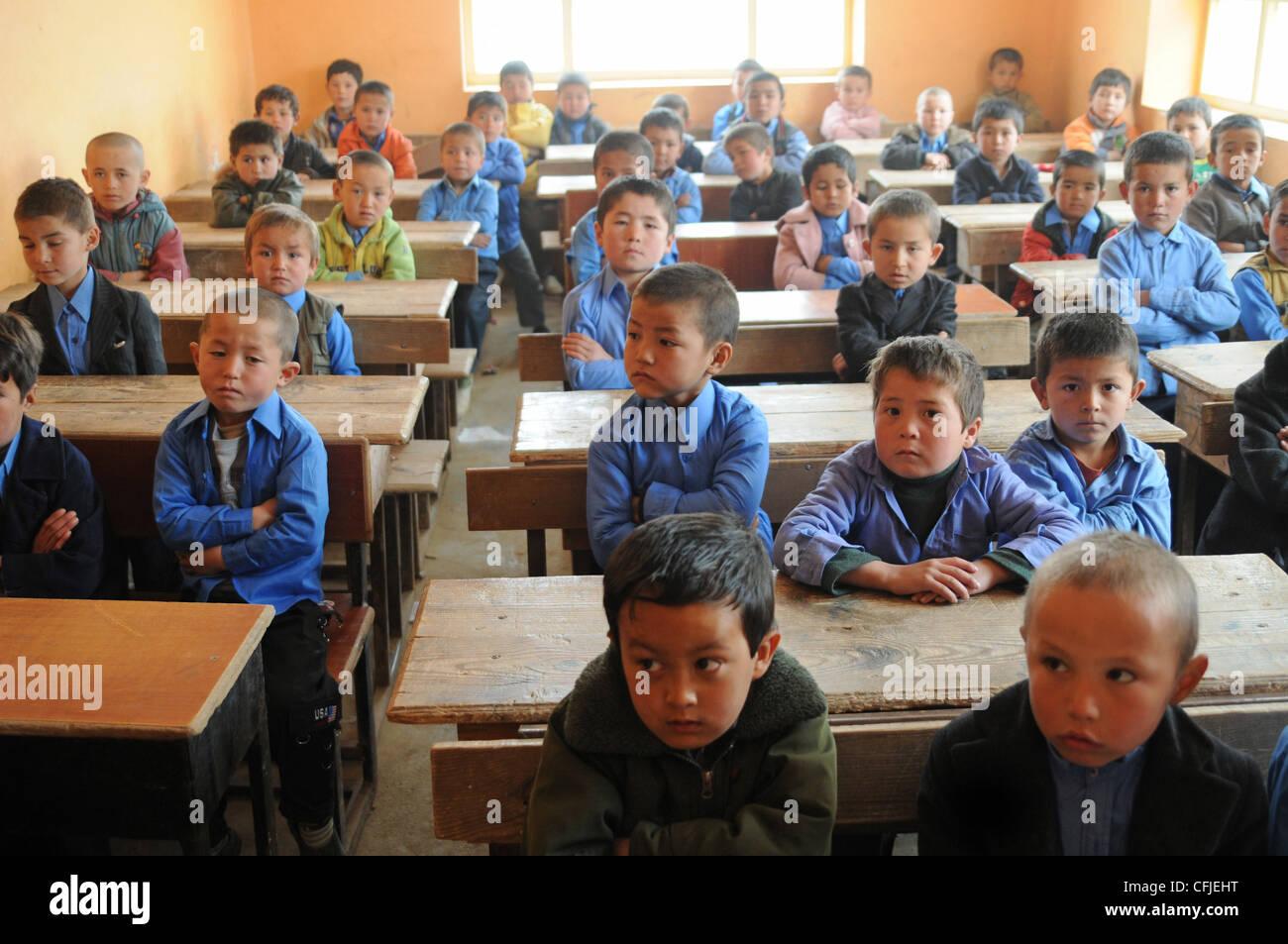 Young Afghan boys sit in their Aliabad School classroom near Mazar-e-Sharif, Afghanistan, March 10, 2012. Their - Stock Image