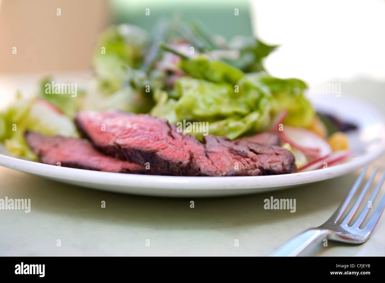 Sliced strip steak salad - Stock Image
