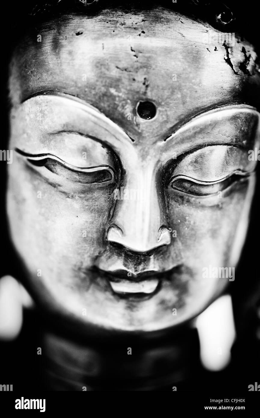 White Tara face Statue. Buddhist deity statue. Monochrome - Stock Image